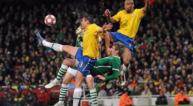 Ireland striker Kevin Doyle is challenged by Brazilian duo Lucio, left, and Maicon during their friendly at the Emirates last night STEPHEN MCCARTHY/SPORTSFILE