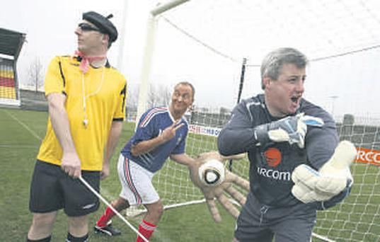 At the release of Paddy Power's 2009 results, Chief Executive Patrick Kennedy (right), Finance Director Jack Massey (centre) and non-retail and development Managing Director Breon Corcoran (left), recreate the controversial moment that ended Ireland's chances of competing in the 2010 World Cup