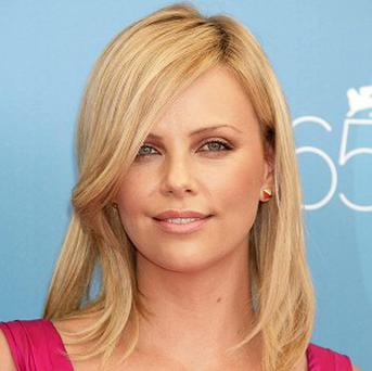 Charlize Theron will be a presenter at the Oscars