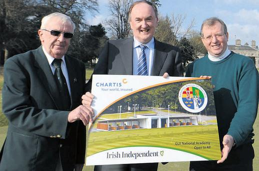 Sean MacMahon (President GUI), Sean Hehir ( Managing Director Chartis Insurance Irl), and Liam Kelly (Irish Independent) display the new GUI members card sponsored by Chartis and The Irish Independent. Distribution to all clubs is under way. Photo: Adrian Melia.