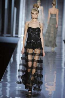 Stunning full length black evening gown by Christian Dior at Paris Fashion Week.