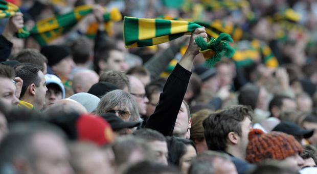 Manchester United fans wave green and gold scarves at a recent match. The colours have become a symbol of protest among fans over the ownership of the club by the Glazer family. Photo: Getty Images
