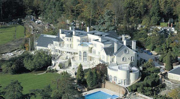 Updown Court in Surrey, a palatial spread that boasts its own 50- seater private cinema as well as 103 rooms, five swimming pools and a heated driveway, was used by the movie's director Paul Greengrass to depict a war-torn Baghdad palace in the city's highsecurity 'Green Zone', and starring Matt Damon