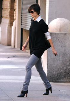 Layer long shirts and jumpers over leggings and skinny jeans, like Katie Holmes has done here. Photo: Getty Images