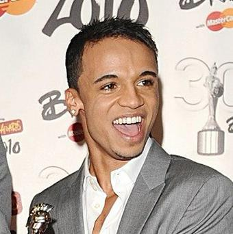 Aston Merrygold of JLS is pleased for Simon Cowell