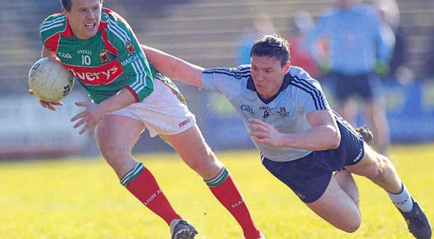 Mayo's Andy Moran in action against Dublin's Eamonn Fennell in Castlebar yesterday.