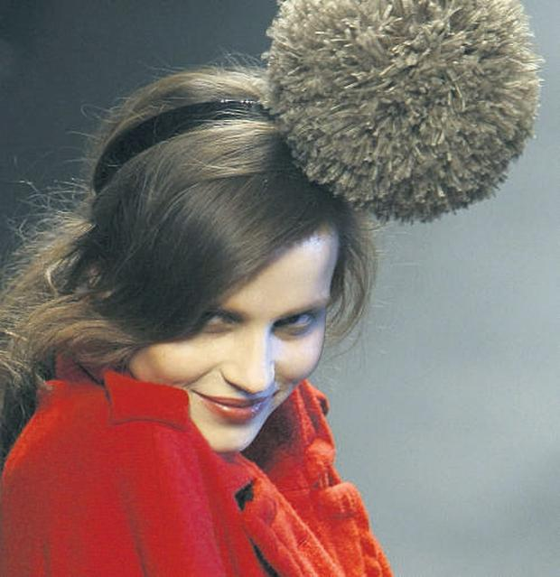 Elaborate headpieces were carefree, fun and irreverent on the catwalk.