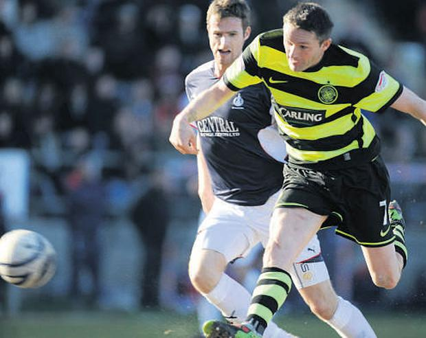 Robbie Keane scores the second of his two goals for Celtic against Falkirk yesterday