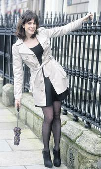 Beige trench, €55, a|wear; black vest, €6, and black high-waisted skirt, €24, both H&M; 40-denier tights with heart motif, €6, Penneys; black shoe boots, €110, Topshop; floral umbrella, €12, TK Maxx.