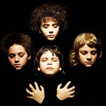 The cover of Queen's second album Queen II has been recreated by children