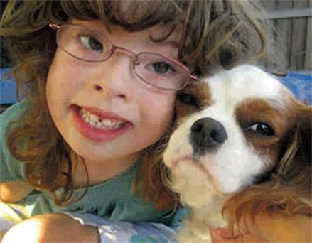 Caoimhe McCooey pictured with her dog, Dr Lucy.