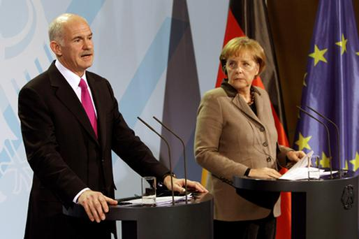 Angela Merkel: pushing for regulation to defend the euro Photo: Getty Images