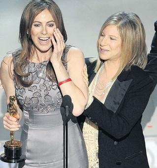 Kathryn Bigelow receives her Best Director Oscar from Barbra Streisand for 'The Hurt Locker'.