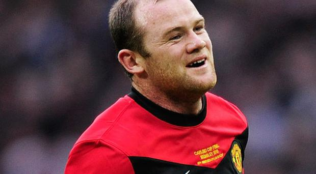 Wayne Rooney will take part in training ahead of tomorrow's encounter with AC Milan Photo: Getty Images