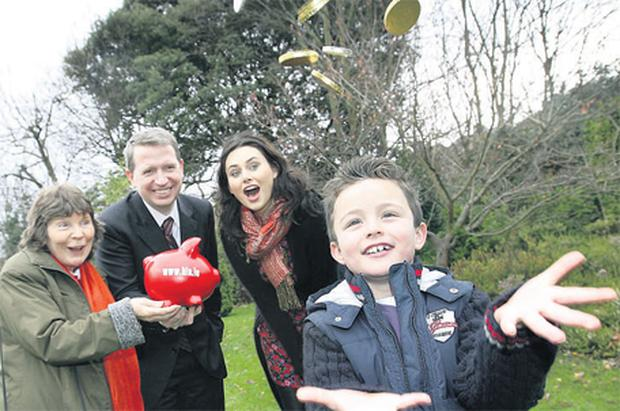 The Health Insurance Authority recently launched its new website www.hia.ie to alert consumers to potential savings of up to 20pc in their health insurance premiums, which could save the average family up to €400 per year. Pictured are Vera Walsh (far left), chief executive of the Health Insurance Authority Liam Sloyan, model mum Corina Grant, and Daniel O'Gorman (8)