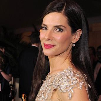 Sandra Bullock says both her Razzie and her Oscar will go on display