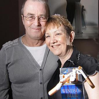 Malcolm Page (left) and Maggie Loftus have quit smoking to save money for their dream wedding