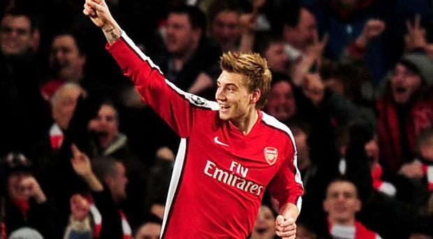Nicklas Bendtner celebrates after opening the scoring at the Emirates against Porto last night Photo: Getty Images