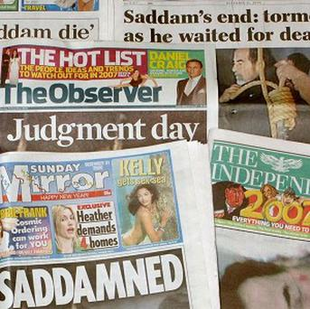 Two MPs have been given a ticking-off for reading newspapers in the Commons
