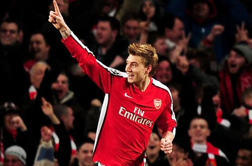 Nicklas Bendtner celebrates scoring Arsenal's second goal in their 5 - 0 rout of Porto at the Emirates Stadium. All Photos: Getty Images