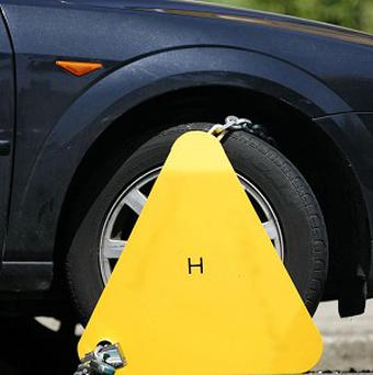 Traffic wardens clamped a van belonging to a private wheel-clamping firm
