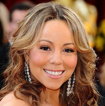 Mariah Carey would like to work with Woody Allen