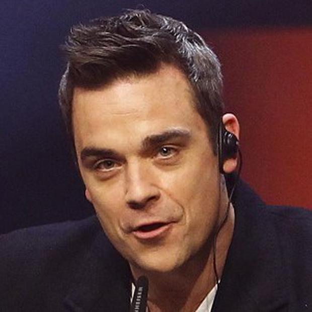 Robbie Williams says he 'doesn't mix well' with marijuana