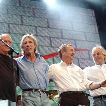 Pink Floyd have challenged EMI's decision to make individual tracks from their albums