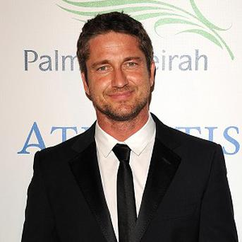 Gerard Butler will walk the red carpet with Jennifer Aniston for the gala premiere of The Bounty Hunter