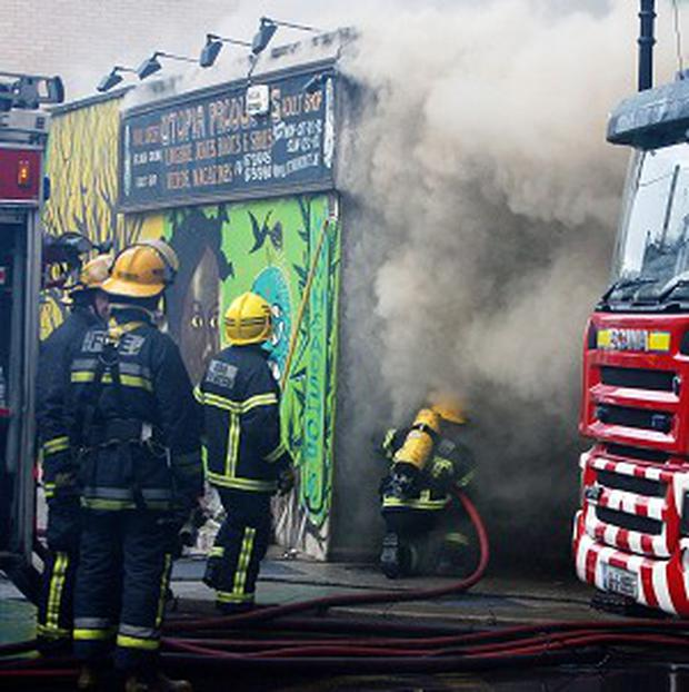 Members of Dublin Fire Brigade tackle a blaze at the Nirvana head shop on Capel Street, Dublin.