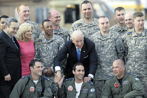 US Vice-President Joseph Biden, centre, meeting American and Israeli troops yesterday