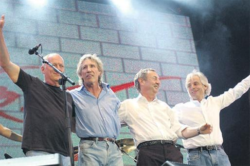 Dave Gilmour, Roger Waters, Nick Mason and Rick Wright of Pink Floyd together on stage as a High Court judge will rule today in a dispute between the rock band and record label EMI