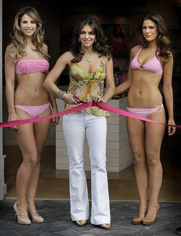 Liz Hurley, flanked by models showcasing her new bikini range, prepares to cut the ribbon at the opening of the Elizabeth Hurley Beach Boutique in Kildare Village outlet centre. All photos: Steve Humphreys