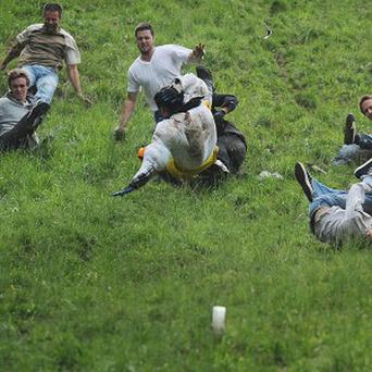 Competitors in one of the annual cheese rolling races at Cooper's Hill, Gloucestershire
