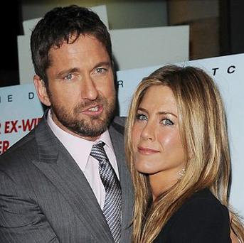 Jennifer Aniston says she is insulted by the rumours about her and Gerard Butler