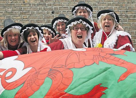 Fans in traditional Welsh dress in Temple Bar, Dublin, yesterday.