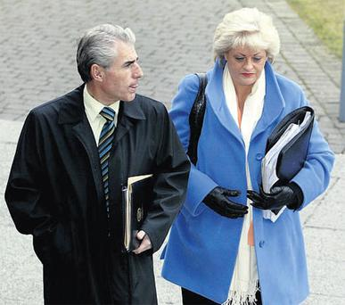 Liam Doran, of the INO, and Patricia King of SIPTU arrive for the talks in the LRC in Dublin yesterday.