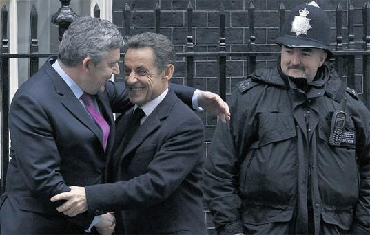 British Prime Minister Gordon Brown greets French President Nicolas Sarkozy on the steps of 10 Downing Street in London yesterday.