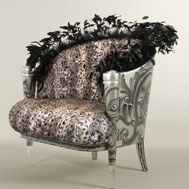 A bergere upholstered in faux leopard fur and edged in Ostrich feathers, ordered by Michael Jackson
