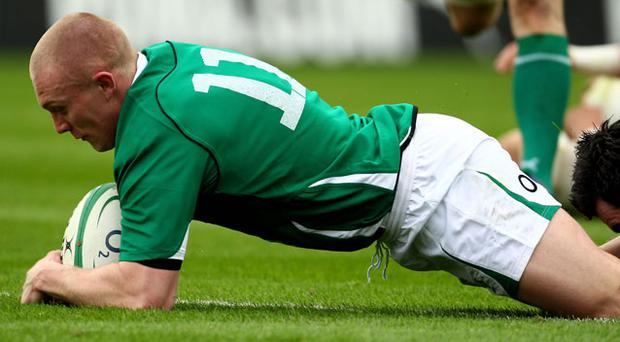 Keith Earls dives over to score the first try of the game in the 26th minute.