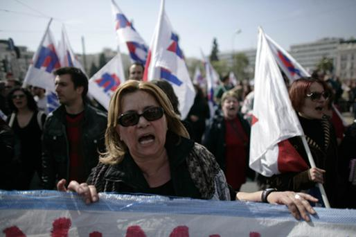 Protesters march through the streets on Thursday in Athens. Photo: Getty Images
