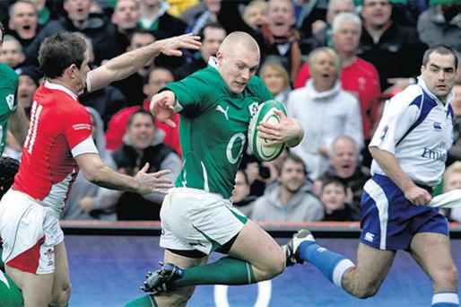 Keith Earls breaks clear of Shane Williams to score his second, and Ireland's third, try in the win over Wales at Croke Park yesterday