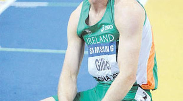 Ireland's David Gillick shows his disappointment after finishing in fifth position in the men's 400m final in Qatar PAT MURPHY / SPORTSFILE