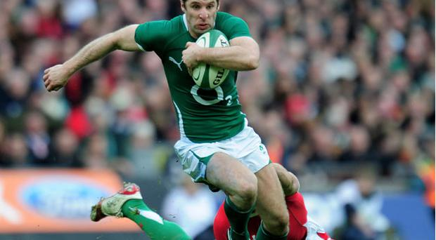 Man of the match Tomas O'Leary breaks through the tackle of Welshman Jamie Roberts Photo: Getty Images