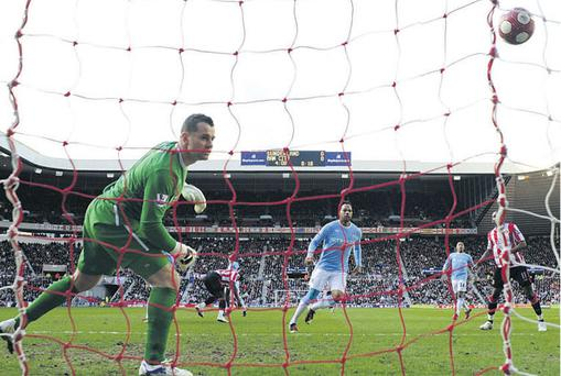 Shay Given can only look on as Kenwyne Jones' header flies into the net