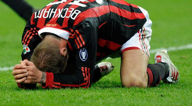 David Beckham has been ruled out of the World Cup after tearing his Achilles tendon during AC Milan's match against Chievo. Photo: Getty Images