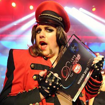Rufus Hound celebrating winning the Let's Dance For Sport Relief final, dressed as Cheryl Cole
