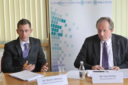 Martin Whelan (left), the Construction Industry Federation's director of policy and research, and Tom Parlon, director general, briefing the press yesterday in Construction House, Canal Road, Dublin 6
