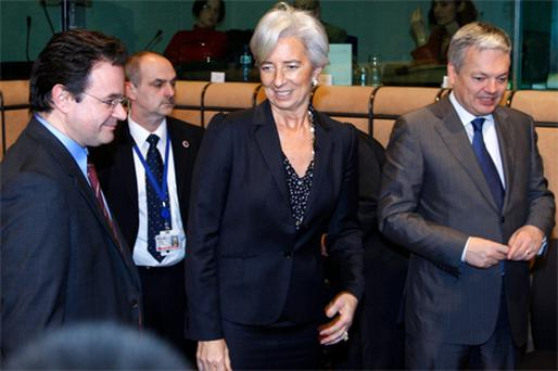 Greece's Finance Minister George Papaconstantinou (left) arrives with his French counterpart Christine Lagarde and Belgian counterpart Didier Reynders at an Eurogroup finance ministers meeting at the EU Council in Brussels yesterday