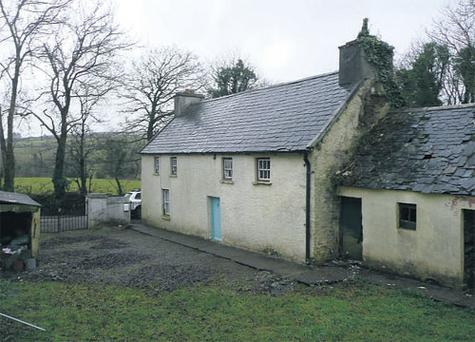 DILAPIDATED: After much interest from the packed auction room, this ruinous farm sold to a local buyer for £425,000 (€170,000/ac)